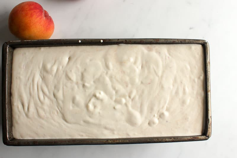 Peach ice cream in a loaf pan.