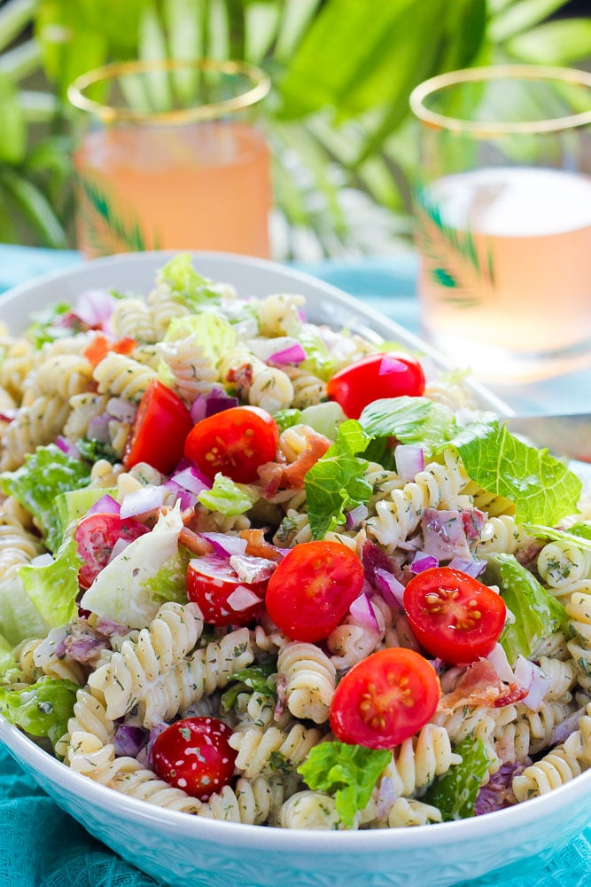 Serving bowl full of bacon, lettuce, tomato pasta salad with creamy sauce.