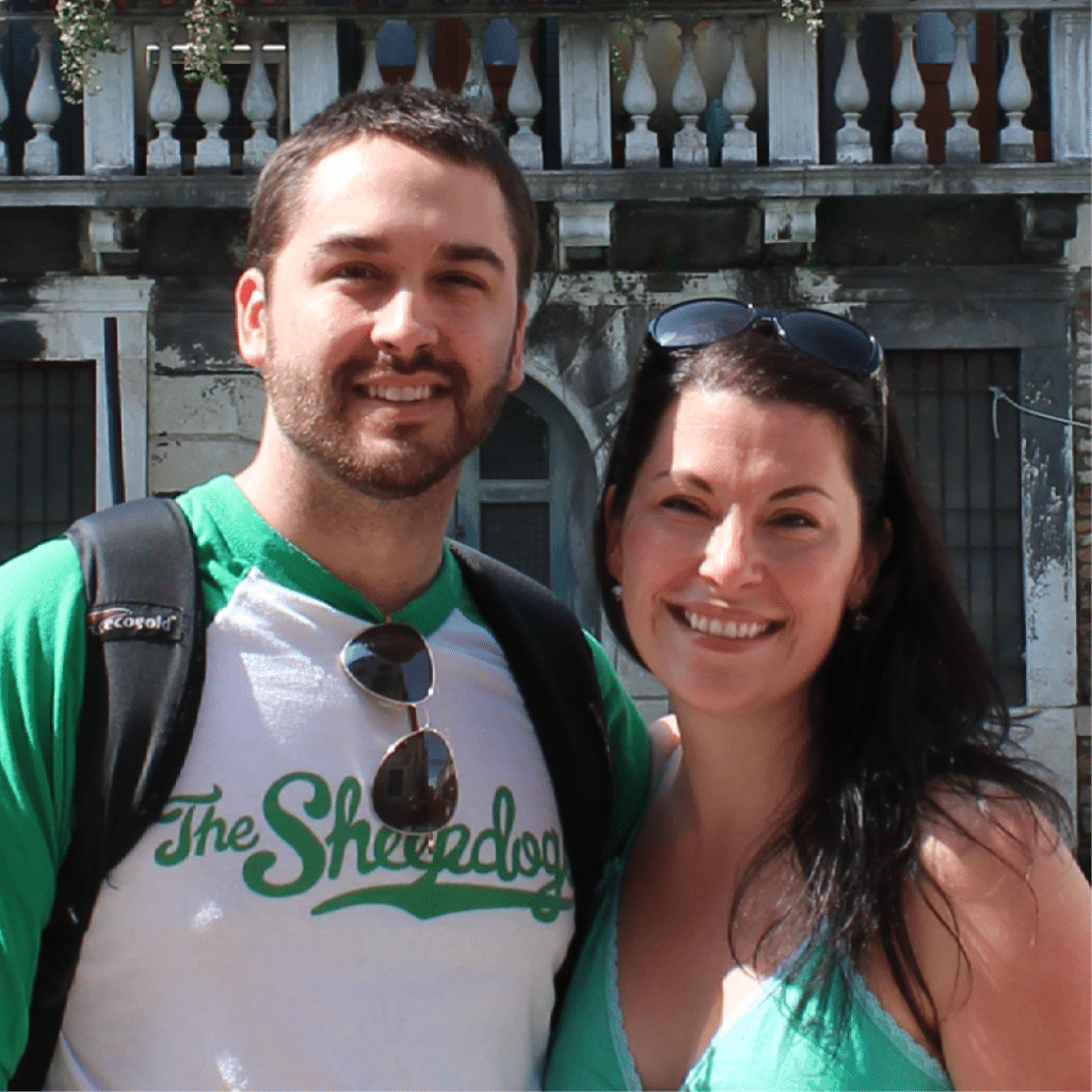 A photo of a man and a woman in front of a building.