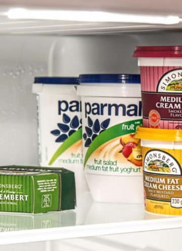 Yogurt packages inside of refrigerator.