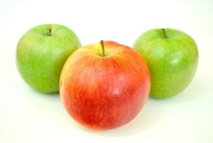 A red apple between 2 green apples.