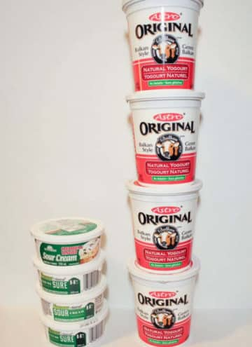 Yogurt and sour cream tubs stacked.