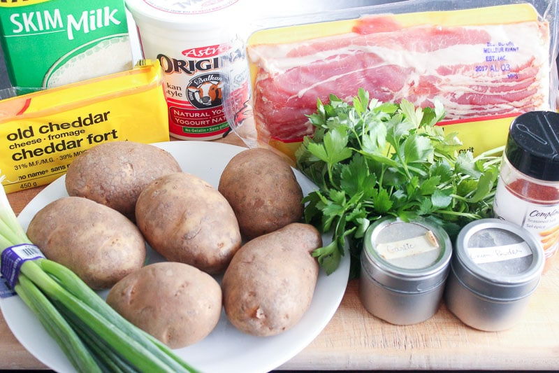 Twice Baked Potatoes Ingredients on Wooden Board.