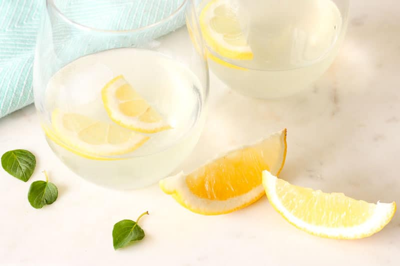 Glasses of Mint Lemonade, Ice Cubes and Lemon Wedges.