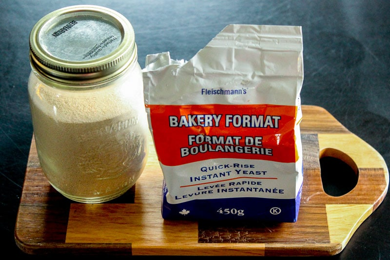 Yeast in Mason Jar and in Package on Wooden Board.