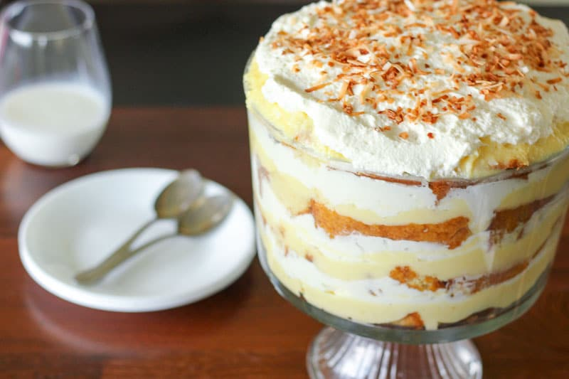 Coconut Cream Trifle topped with Toasted Shredded Coconut in Glass Trifle Bowl.