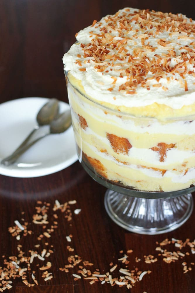 Coconut Cream Trifle topped with Whipping Cream and Toasted Shredded Coconut.
