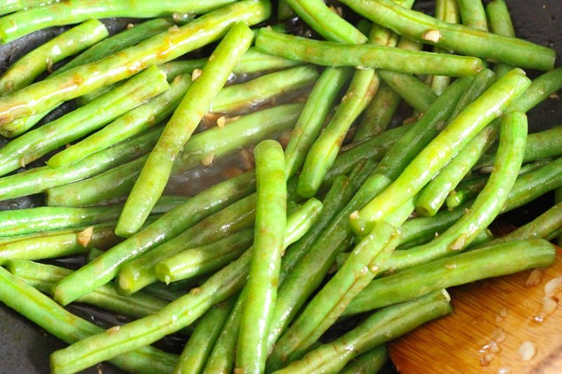 Green Beans and Garlic Frying in Wok.