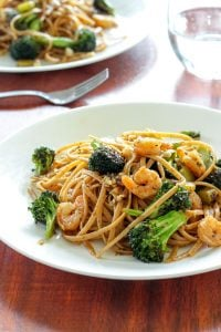 Cajun Pasta topped with Shrimp and Broccoli in White Plate.