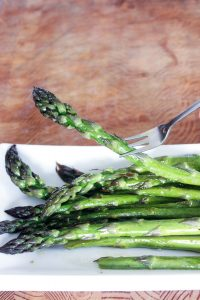 Oven Roasted Asparagus on White Plate.