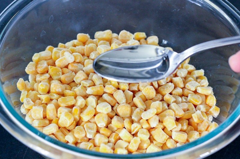 Frozen Corn in Glass Mixing Bowl.