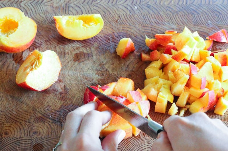 Chopped Peaches on Wooden Board.