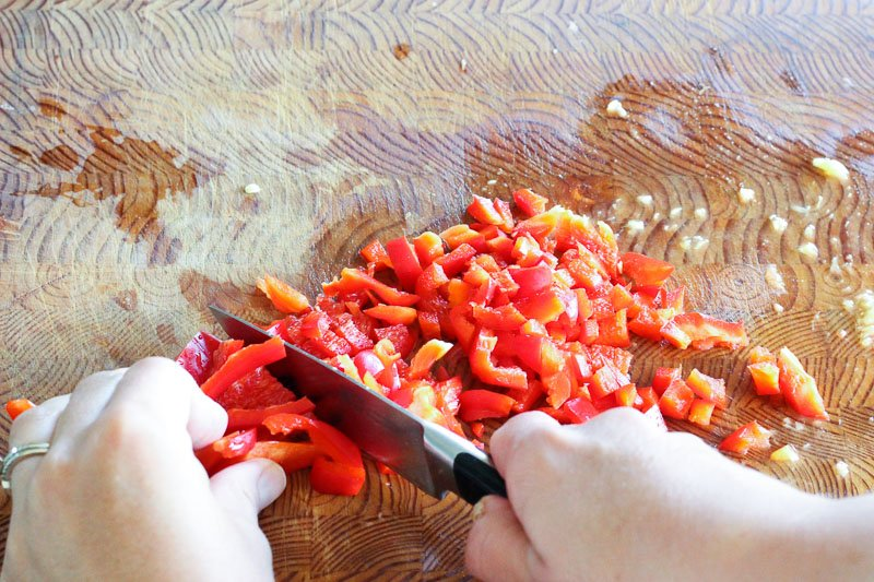 Chopped Red Pepper on Wooden Board.