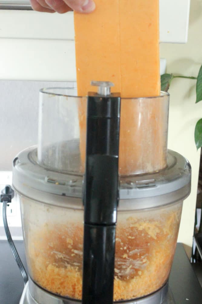 Putting Cheddar Cheese into Food Processor.