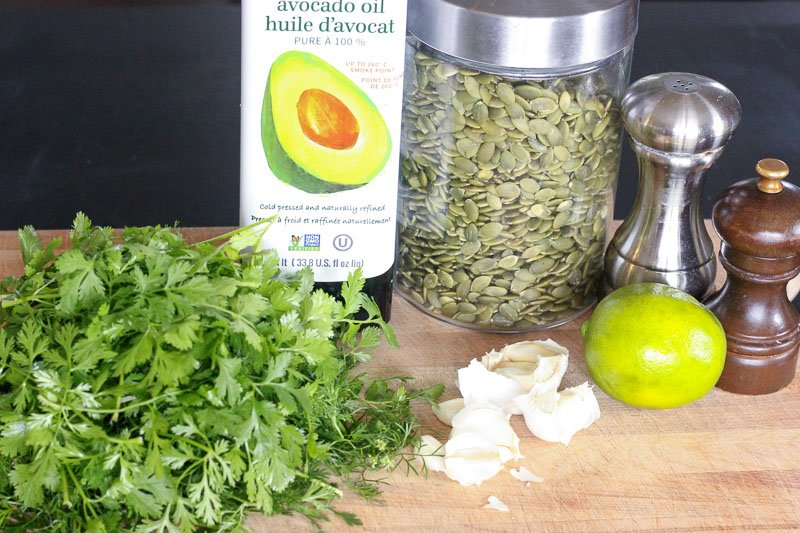 Cilantro Pesto Ingredients on Wooden Board.