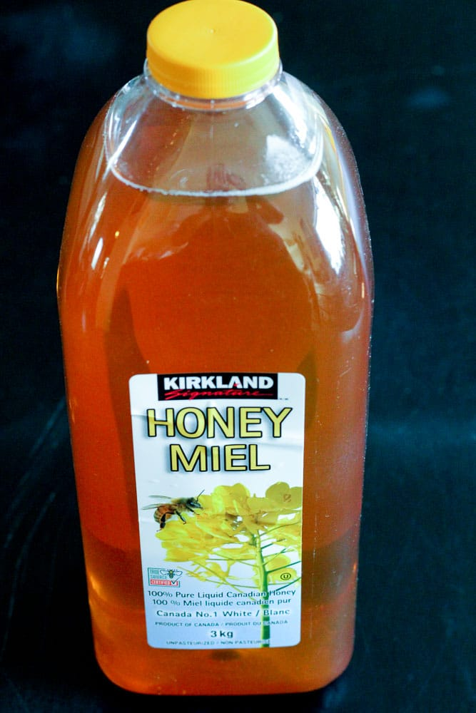 Bottle of Honey with Yellow Cover.