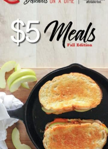 Grilled cheese in black cast iron frying pan.
