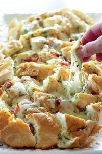 Sliced Garlic Bread topped with Bacon, Parsley and Mozzarella Cheese.