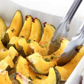 Sliced baked squash in white dish.