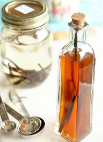 Vanilla in glass bottle with cork top.