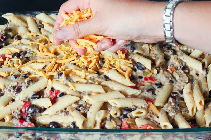 Sprinkle cheese over top of mixture in casserole dish for Chile Con Queso Pasta Bake
