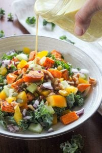 Healthy Fall Salad with Kale and Sweet Potatoes and Topped with Creamy Maple Curry Dressing.