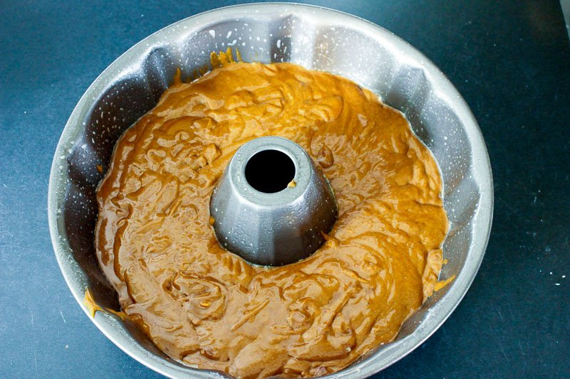 Pour cake batter into bundt pan or 9x9 pan for Warm Gingerbread Cake with Salted Caramel Sauce