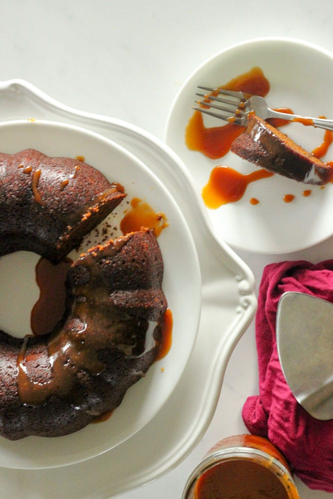 Warm Gingerbread Cake with Salted Caramel Sauce - easy to make ahead and the perfect Thanksgiving dessert!