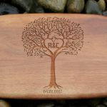 Wooden Cutting Board with Tree of Life Logo.