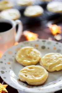 Three Soft Eggnog Cookies on White Plate.