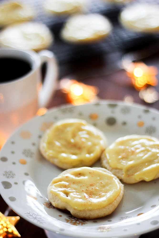 Three Eggnog Cookies in white plate.