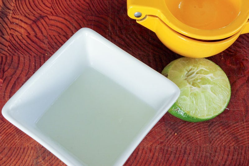 Lime juice in small square bowl.