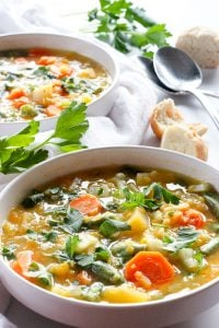 Hearty Vegetable Soup in White Bowl.