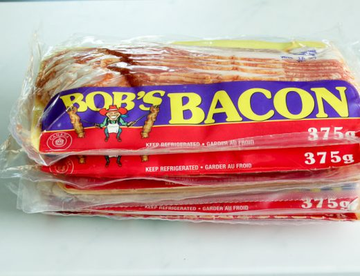 Stack of five packages of bacon - stock up on bacon