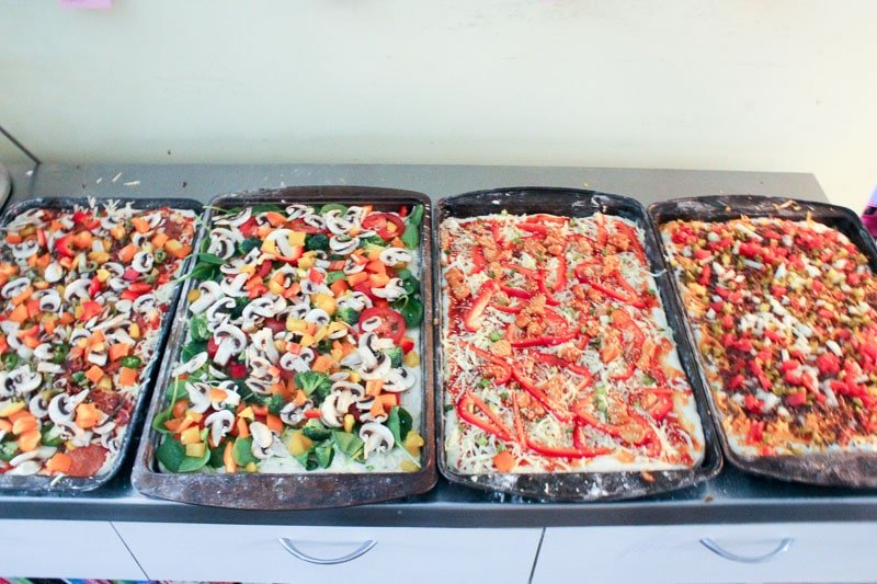 Add other pizza toppings for Homemade Freezer Pizza - Easy Freezer Meals