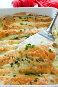 White Chicken Enchiladas topped with Parsley in White Baking Dish.