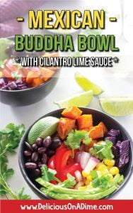 Two black bowls, filled with cubes of sweet potato, sliced red pepper, black beans, diced red onion, sliced avocado, kernels of corn and pieces of red cabbage, with white sauce drizzled over it, set on a table with a white sauce in a jar, some lime wedges, loose cilantro and a purple cloth. Text overlay says Mexican Buddha Bowl with Cilantro Lime Sauce.