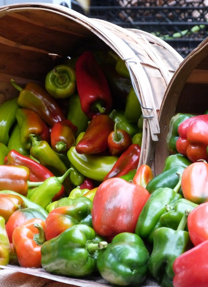 Baskets of coloured peppers