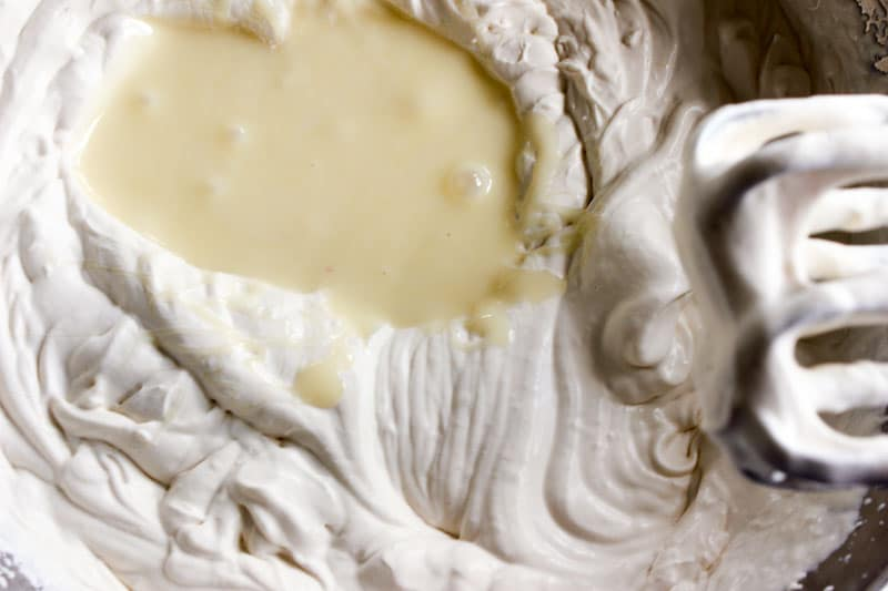 Whipped cream with sweetened condensed milk poured into it
