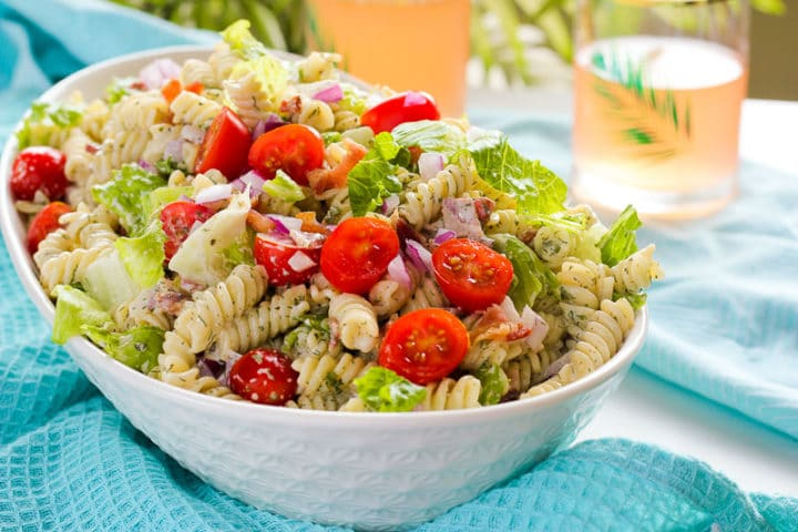 Serving dish of BLT Ranch Pasta Salad with drinks