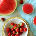 Strawberries, watermelon and red juice on a table