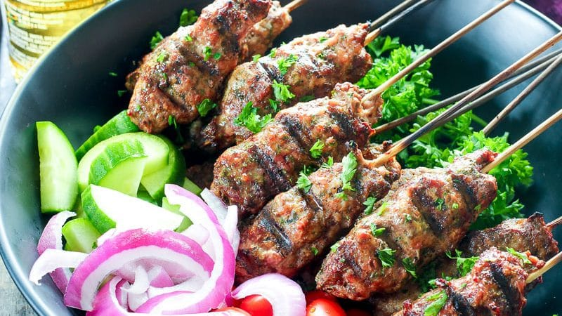 Platter of beef kebabs, cucumber, red onions and grape tomatoes