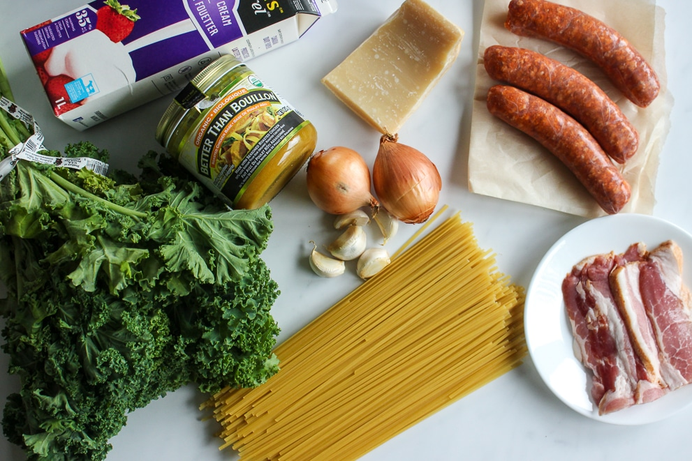Bunch of kale, chicken bouillon, onions, garlic, linguine noodles, whipping cream, Parmesan cheese, sausages and bacon