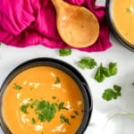 Bowl of orange Thai butternut squash soup ready to eat!