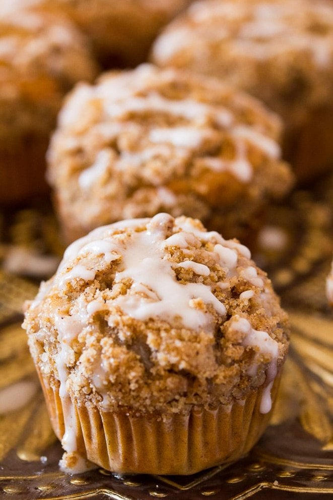 Close up of banana muffins with streusel and vanilla drizzle
