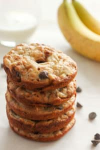 Stack of banana chocolate chip donuts, with glass of milk