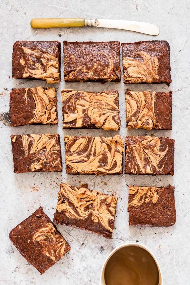 Cut up banana brownies with slighter swirl on top on cutting board
