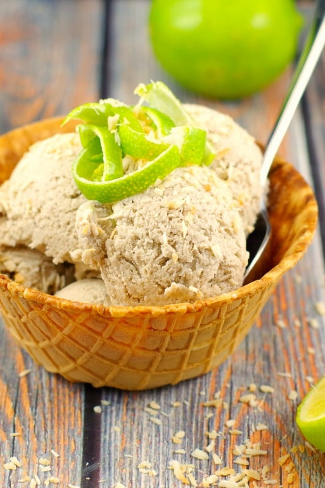 Waffle bowl filled with coconut lime banana ice cream, with lime zest on top