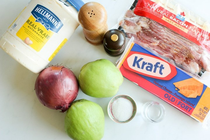 Ingredients for chayote salad - mayo, red onion, chayote squash, cheddar cheese, bacon, sugar, vinegar, salt and pepper