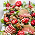Platter of Strawberry Chicken Salad with sliced apples, walnuts and goat cheese